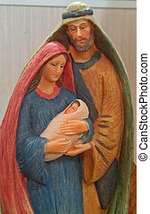 Mary, Joseph, and Jesus - A figurine depicting Mary, Joseph...