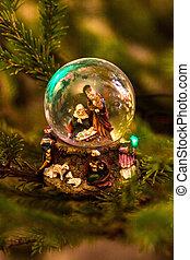 Mary, Joseph and Jesus in snow globe