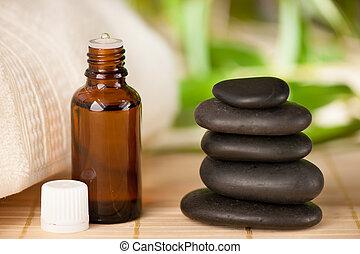 masage, aromatherapy olie, fles, rotsen