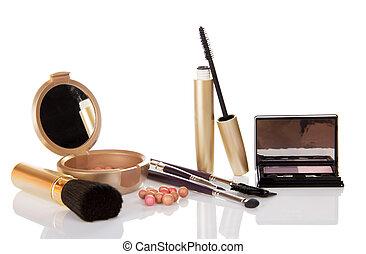 Mascara, eye shadow, the blush isolated on white background