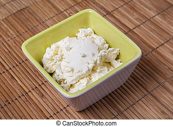 Fresh Italian cheese mascarpone in a bowl.