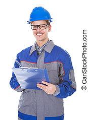 maschio, costruzione, reviewer, tenendo penna, e, appunti