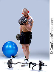 Masculine and fit man lifting weights