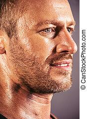 masculine - Close-up profile of a handsome mature man.