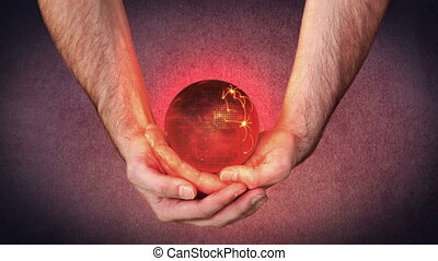 Masculine hands holding a 3d planet globe and activating...