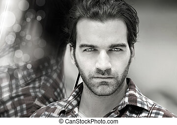 Masculine man face - Closeup desaturated styled portrait of...