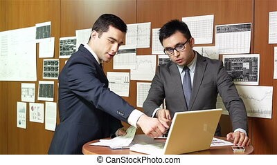 Masculine Team - Elegant businessmen meeting to discuss the...