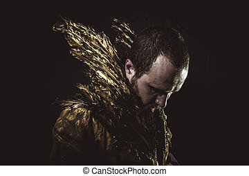 Masculinity, man beard and suit made with golden wings