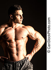 masculinity - Handsome muscular bodybuilder posing over...