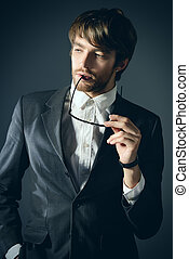 masculinity - Portrait of a handsome man in elegant black...