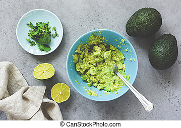 Mashed avocado guacamole sauce in bowl - Mashed avocado ...