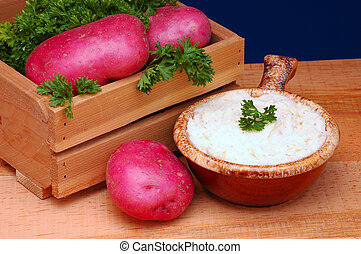 Mashed Potatoes and Crate of Red Potatoes
