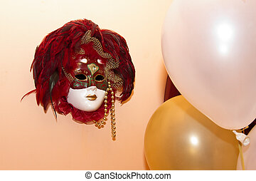 Mask and balloon on the wall