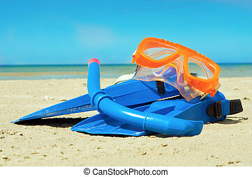Mask and flippers on a beach