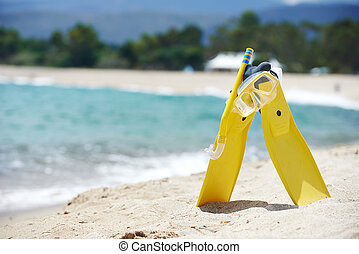 Mask and flippers on the beach