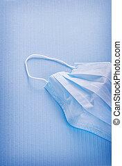 mask on blue background medical concept