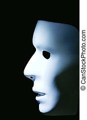 Mask Profile - Profile of a white mask against a black...