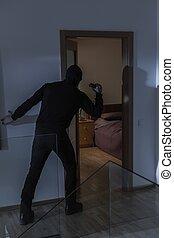 Masked intruder in house