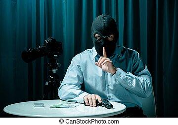 Masked killer with gun