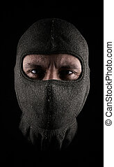 Masked man on a dark background