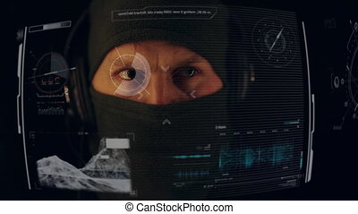 Man in the mask using control futuristic data hologram panel on black background