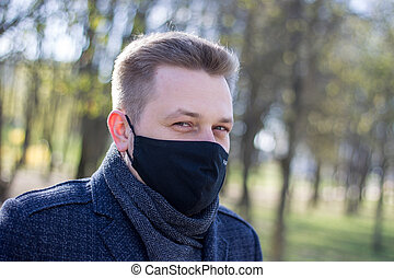 Masked man walking in the park