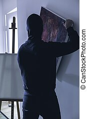 Masked thief of artwork