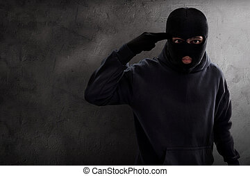Masked thief threatening
