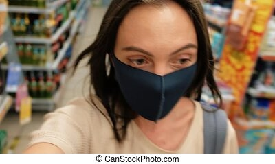 Masked woman goes shopping - Woman after quarantine and ...