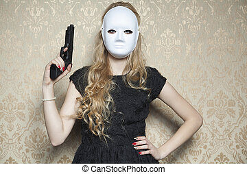 masked woman with a gun in hand