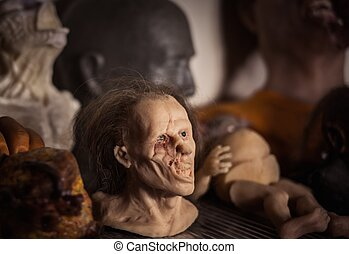 Masks and dummies on a shelf in prosthetic special fx...