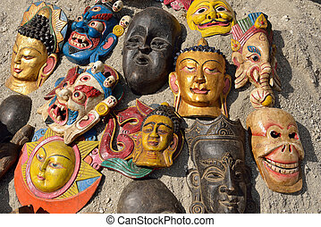 Masks, pottery, souvenirs, hanging in front of the shop, ...