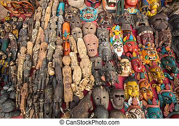 Masks, souvenirs, in street shop, Kathmandu, Nepal.