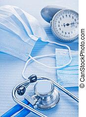 masks stethoscope blood pressure monitor on blue background medi