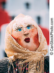 Maslenitsa effigy out of straw, decorated with pieces of rags