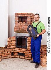 Mason building fireplace