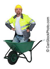 Mason kneeling in wheelbarrow