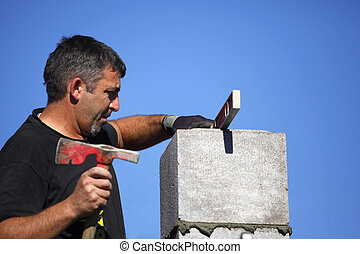 Mason making adjustment to wall