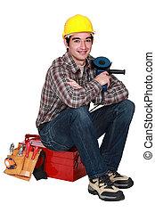 Mason sitting on toolbox