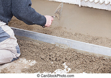 mason smooth the cement screed with trowel