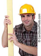 Mason stood with plank of wood