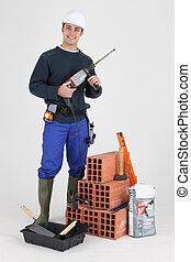 Mason stood with power drill