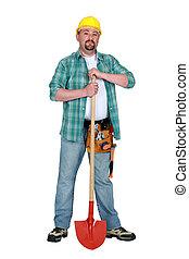 Mason stood with shovel