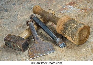 Mason tools on a sandstone slab