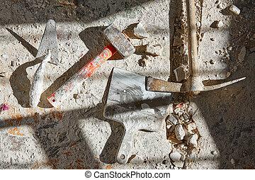 Mason tools on debris background