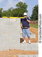 Mason with Concrete Block