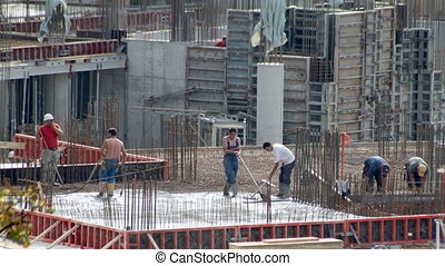 Mason workers - Construction workers on the building site