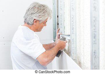 Mason working on a wall