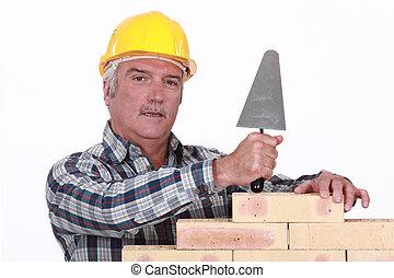 mason working with a trowel