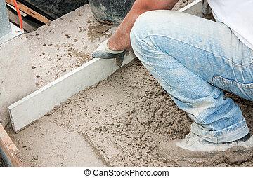 Masonry - Mason building a screed coat cement